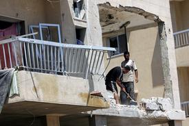 Lebanon, after blockade, haltingly starts to rebuild