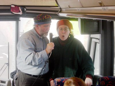 Singing bus riders for peace