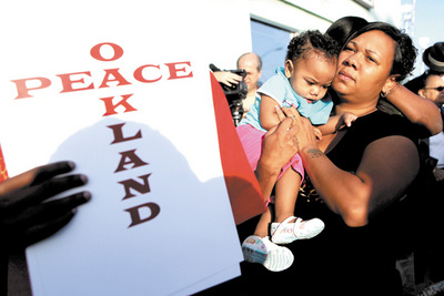 Oakland responds to slayings with a vision of community