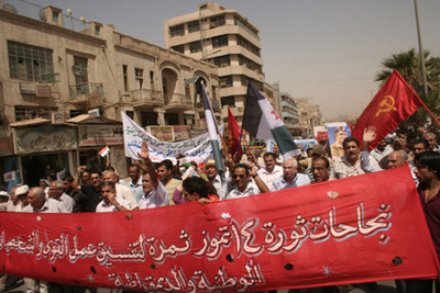Communists march in Baghdad to mark 1958 revolution