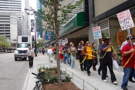 Wells Fargo guilty of crimes against workers, rally charges