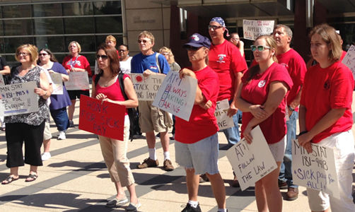 Minnesota, workers want AT&T to comply with state paid leave law