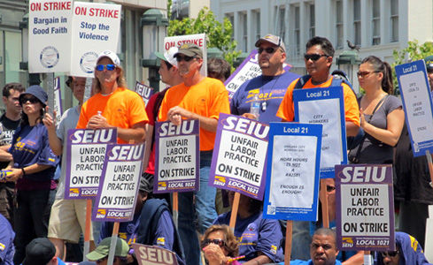 Striking rapid transit, city workers rally in Oakland, Calif.