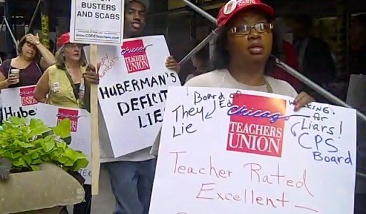 Teachers, parents protest school layoffs