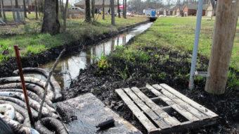 Arkansas oil spill paints town black, pipeline risks exposed