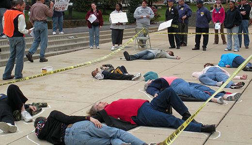St. Louis activists stage die-in at Wellpoint