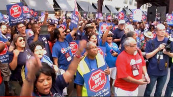 Postal workers and supporters rally to save the mail