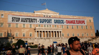 Greece on the brink as default passes