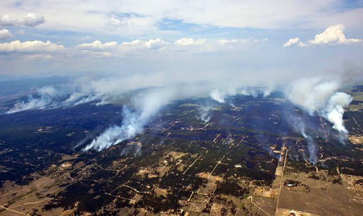 Colorado fires blaze on as workers rush to fight them