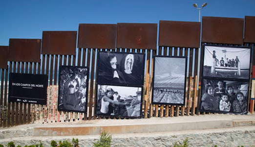 """""""In the Fields of the North"""" photos on the border wall"""