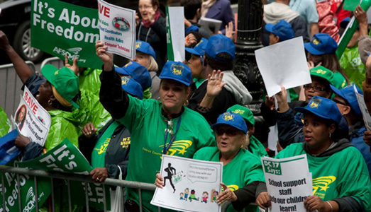 NYC public workers battle Bloomberg, with video