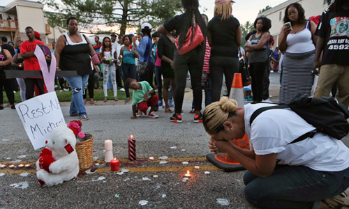 Ferguson, Missouri residents grieve and protest in wake of killing by police