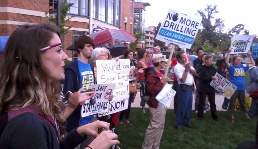 Activists rally outside Ohio Governor Kasich's energy summit