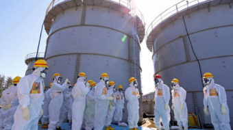 Workers hit with radioactive water as Fukushima disaster continues