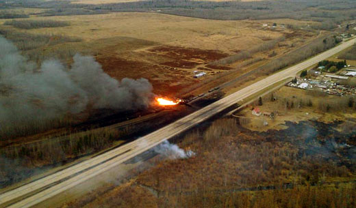 Train carrying oil derails, sets Alberta town ablaze