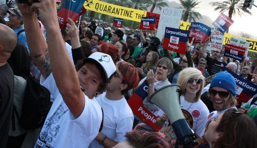 Union members march on Koch billionaire secret meeting