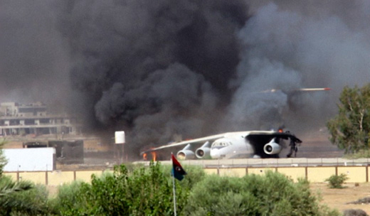 Oil depot ablaze, Libyan government appeals for help