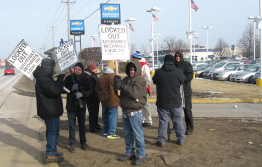 Striking auto mechanics locked out, putting up a fight