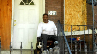 Foreclosed homeowner stands his ground on his own porch