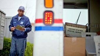 A mailman offers a big bear hug in sympathy and harmony