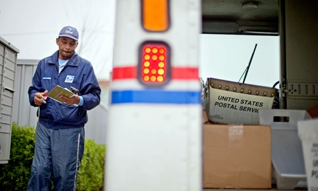A mailman offers a big bear hug in sympathy and harmony
