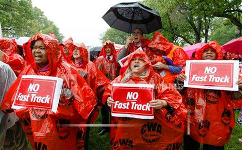 Unionists storm Capitol Hill to lobby lawmakers vs. fast-track