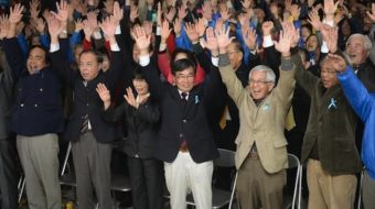 In Okinawa, anti-base mayor's re-election sends a message