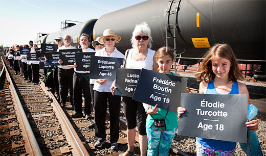 Vigil held for explosion victims as criticism of oil trains broadens