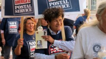 Workers demonstrate to save the U.S. mail