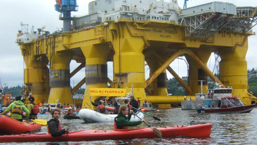 """Kayakers paddling in Seattle Port chant, """"Shell No"""""""