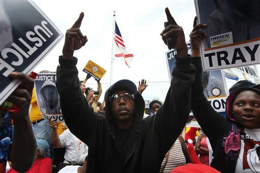 """Thousands vow """"no justice, no peace"""" at Sanford rally"""