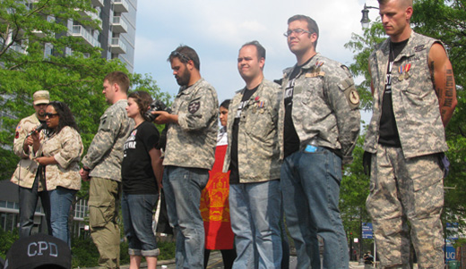 Iraq and Afghanistan veterans return medals at NATO protest