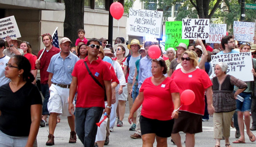 "Thousands rally at N.C. Moral Monday vowing ""silence never again."""