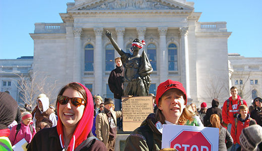 Record protests rock Wisconsin, workers stand firm in Indiana