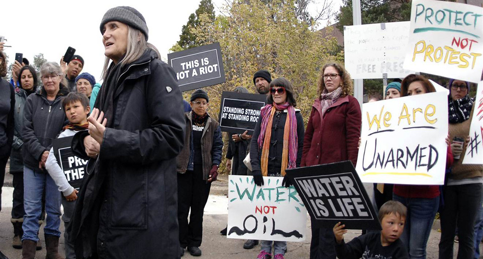Amy Goodman riot charge dismissed, others still endangered