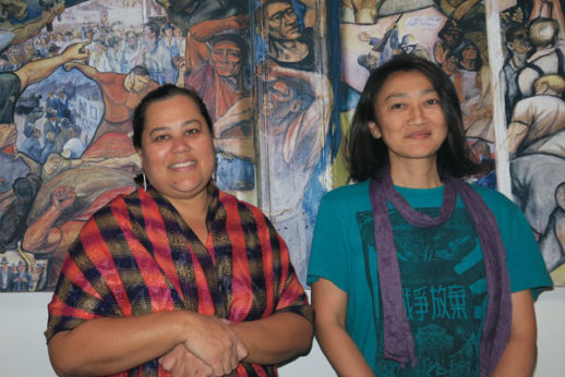Dr. Lisa Linda Natividad (left) and fellow activist Kosuzu Abe (right) at the Peter Symon Building in Sydney. | Guardian