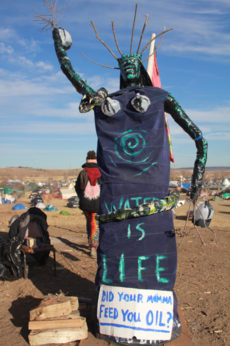 NO DAPL statue posted at entrance of Oceti Sakowin camp. Michelle Zacarias | PW