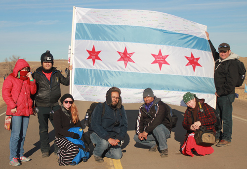Chicago-based water protectors gather to protest the pipeline site in North Dakota. Michelle Zacarias | PW