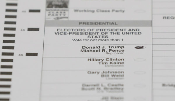 A ballot marked for Donald Trump is shown during a statewide recount in Waterford Township, Mich. on Dec. 5, 2016. | Paul Sancya / AP