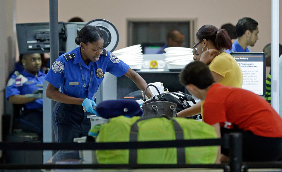 Airport screening officers win battle for job security
