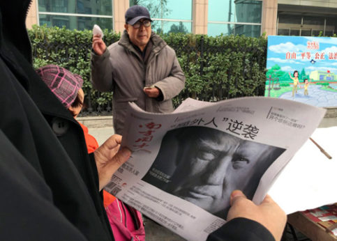 "A Chinese man holds up a newspaper on Nov. 10, 2016 with a front page photo of U.S. President-elect Donald Trump with the headline: ""Outsider counter attack."" 