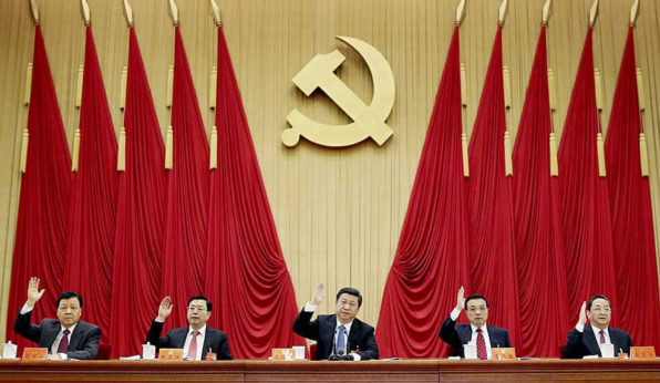Xi, center, is also the General Secretary of the governing Communist Party of China. | Xinhua/AP