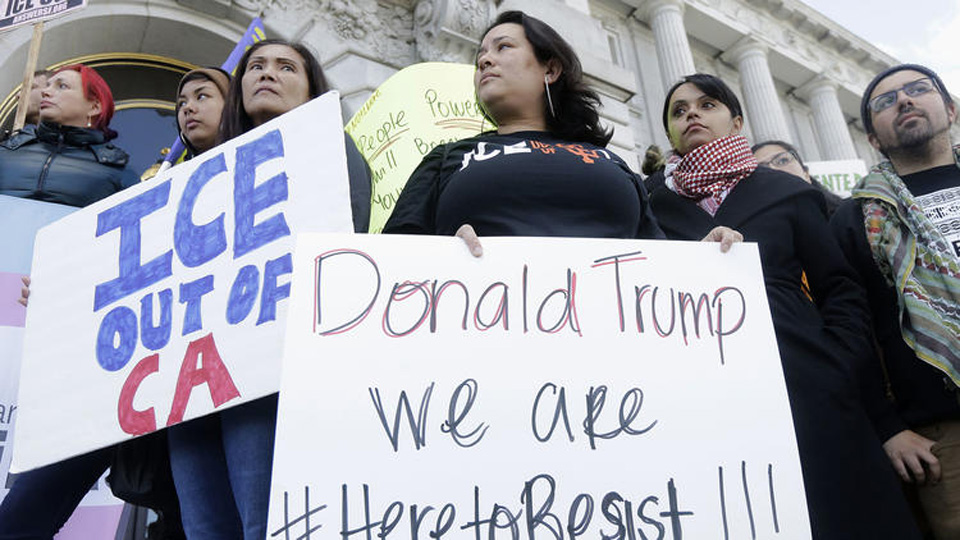 Defying Trump's threats, cities, states move to lock in sanctuary status