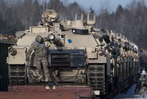 Tanks from the U.S. Army's 4th Infantry Division on rail cars as they arrive at the Gaiziunai Railway Station some 70 miles west of the Lithuanian capital, Vilnius, on Feb. 10, 2017. As part of the NATO military alliance, U.S. military forces have now pushed all the way into former Soviet territory and right up to the Russian border. | Mindaugas Kulbis / AP