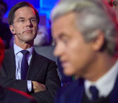 Dutch Prime Minister Mark Rutte, left, and PVV party leader Geert Wilders, right, wait to take their turn in the closing debate at parliament in The Hague, Netherlands, Tuesday, March 14. | Phil Nijhuis / AP