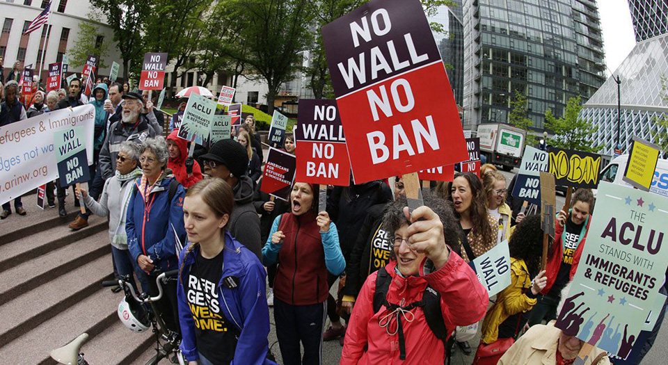 Federal judge hands a partial defeat to Trump's travel ban