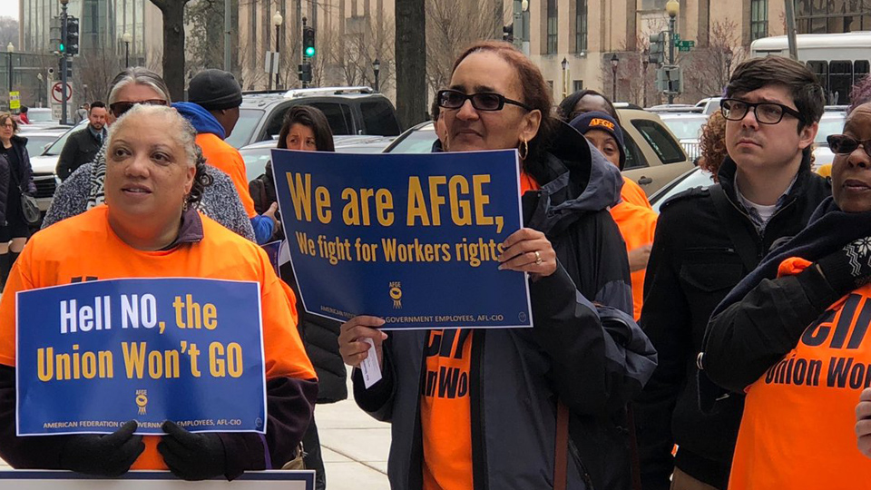 Government employees warn anti-union drive at Education Dept could spread