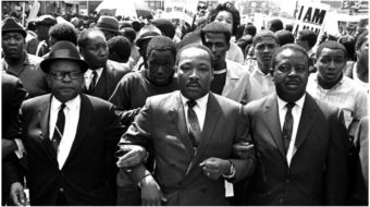 If Dr. King were alive today, he'd be marching