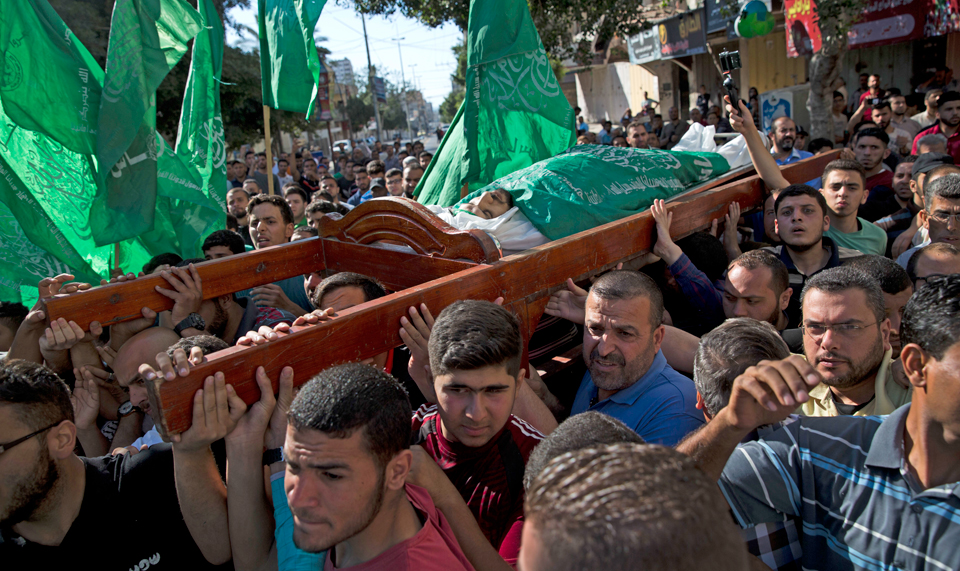 Palestinians bury those gunned down by Israel