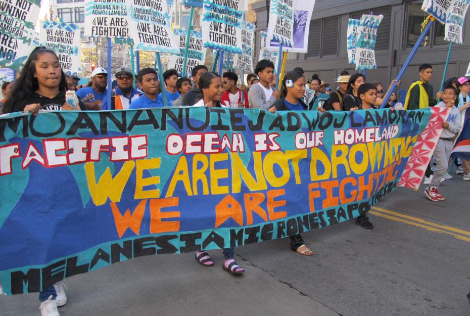 Tens of thousands march for climate, jobs and justice